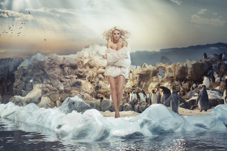 Alluring woman on the cold island with penguins