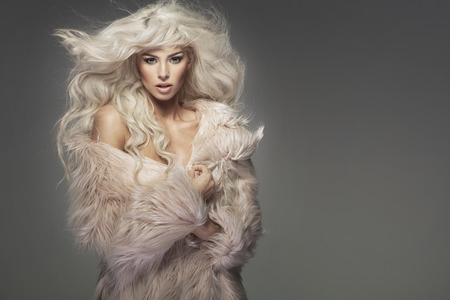 Sensual lady wearing the fur coat