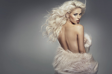 nude blond: Nude blond girl wearing the fur coat