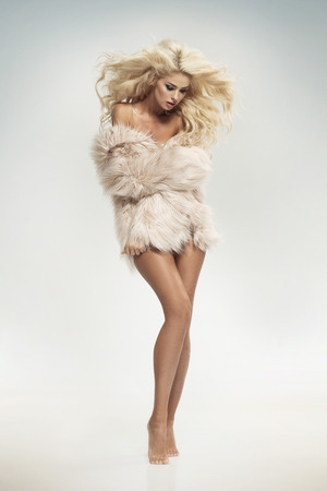 Sensual blond woman wearing fur Stock fotó