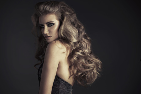 Sensual female model with fabulous hairstyle photo