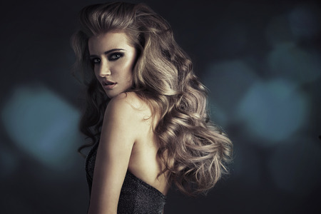 Serious blond lady with amazing look photo