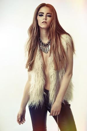 necklase: Classy woman wearing a trendy fur jacket
