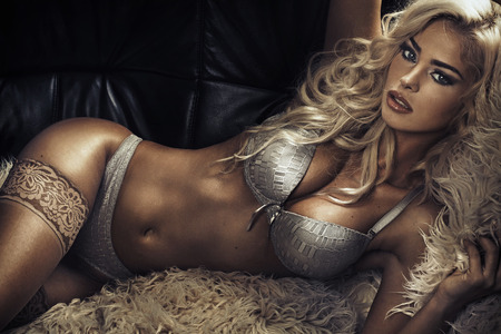 Tawny sensual woman wearing sexy lingerie