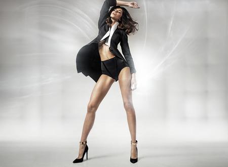 Sensual tall woman on high-heel shoes