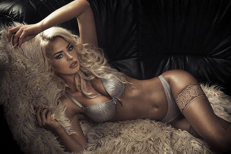 Sensual blond woman wearing sexy lingerie Stock Photo