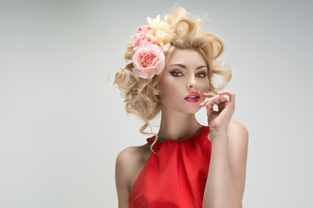Fabulous young girl with a flower hairstyle
