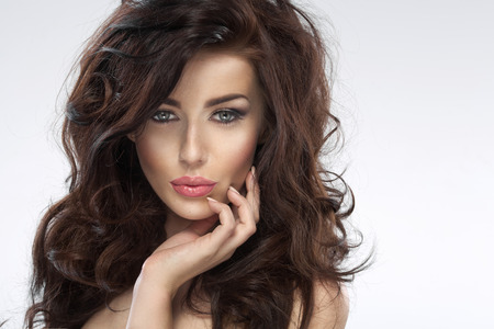 Glad young woman with a fluffy hairstyle