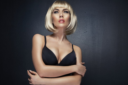 ladies underwear: Portrait of the beautiful young lady wearing blond wig Stock Photo