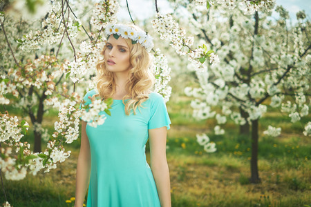 coronet: Blond nymph wearing a white coronet of flowers Stock Photo