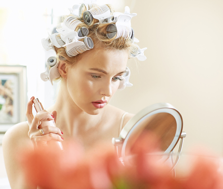 hair curler: Blond woman doing a make up before party