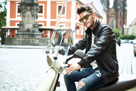 Handsome man driving a motorbike