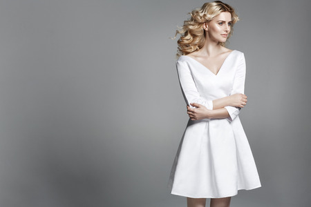 wind dress: Delicate blond woman with a pale complexion