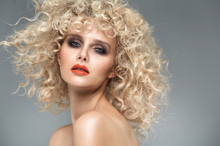 hairpiece: Beautiful blond woman with gorgeous curly coiffure