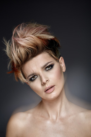 haircut: Pretty woman with a short colored haircut Stock Photo