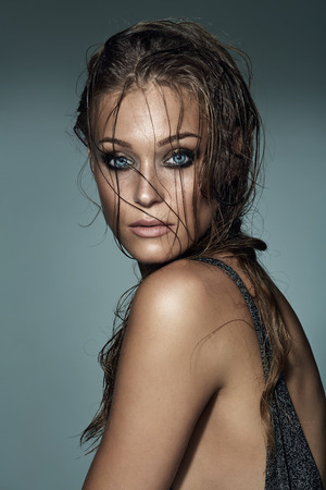 in vouge: Portrait of a sexy fashionable woman with wet hair and gorgeous eyes