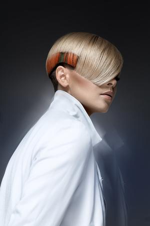 haircut: Blond model with a modern haircut