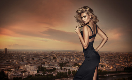 Blond woman posing on the building's roof