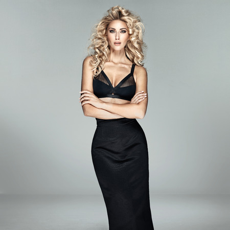 busty woman: Fashion shot of a beautiful blond lady Stock Photo