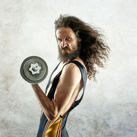 Portrait of a funny, skinny bodybuilder