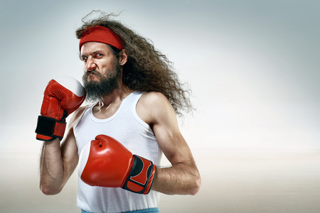 Skinny boxer wearing red boxing gloves