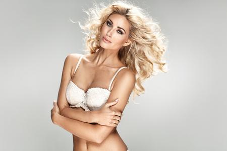 nude blonde girl: Seductive blond woman wearing sexy underwear Stock Photo