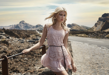 Beautiful blond girl with mountains in the background photo