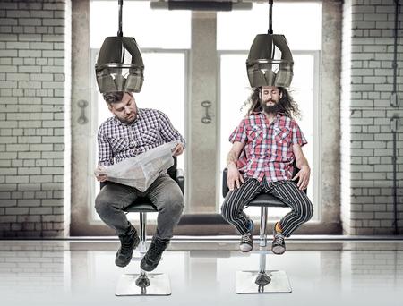 Portrait of a two funny, bored men at barber's Standard-Bild