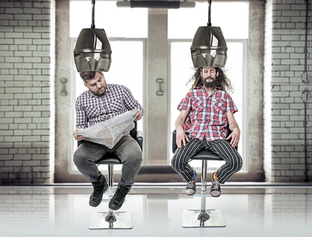 Portrait of a two funny, bored men at barber's Stockfoto
