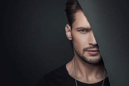 Fashion style portrait of a muscular man