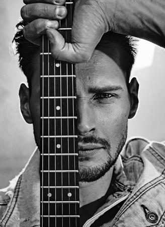 Black&white portrait of a guy holding a guitar Stok Fotoğraf