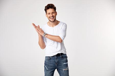 Handsome young guy posing in studio - isolated Standard-Bild