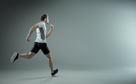 Running young male athlete - isolated