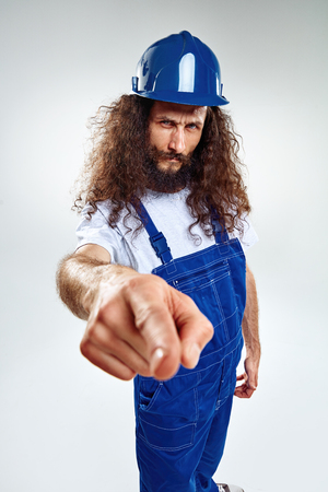 Portrait of a thin craftsman wearing blue uniform