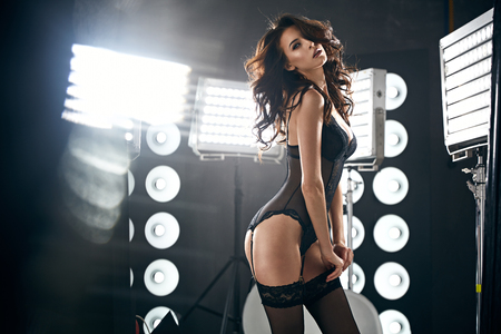Sensual young lady wearing sexy, black lingerie