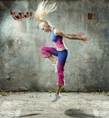 Pretty blond lady dancing in a grungy place