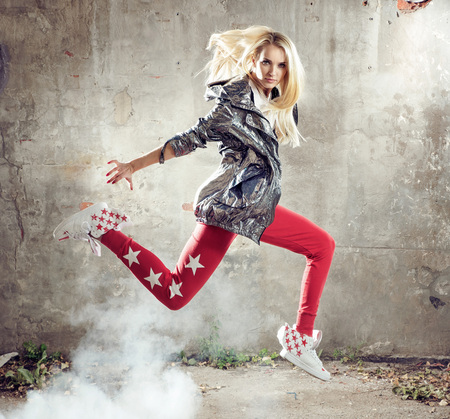 Pretty blond breakdancer in a jump - move