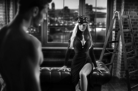 Black&white portrait of sensual lovers in a stylish brick room Stok Fotoğraf - 116848274