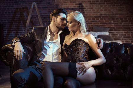 Two sensual lovers in a modern, stylish apartment Фото со стока