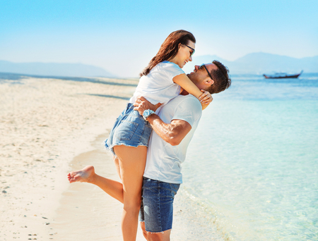 Portrait of a young couple relaxing on the tropical beach