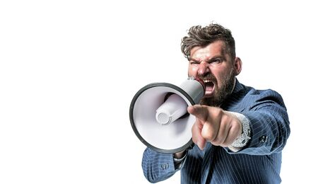 Portrait of an angry leader screaming with a megaphone
