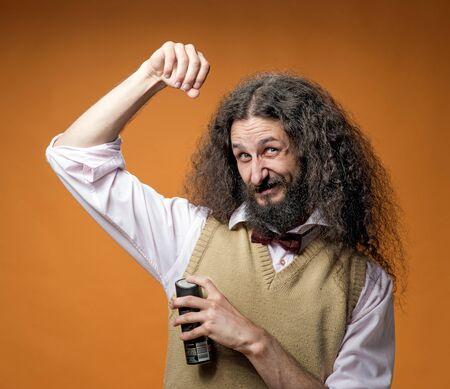 Freaky nerd using a fragrant antiperspirant