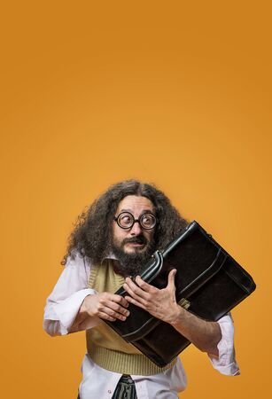 Portrait of a freaky, cheerful professor holding a briefcase