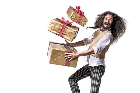 Conceptual portrait of a colorful man running with a bunch of presents