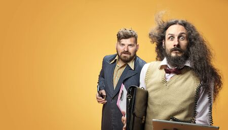 Funny portrait of a two nerdy businessmen