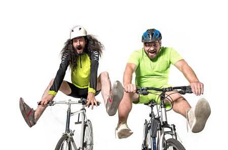 Two eccentric friends riding a bikes - team work Stok Fotoğraf