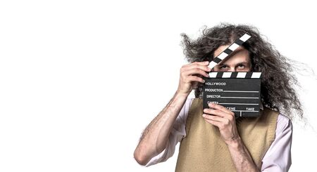 Portrait of a guy holding a clapperboard. White, empty background.