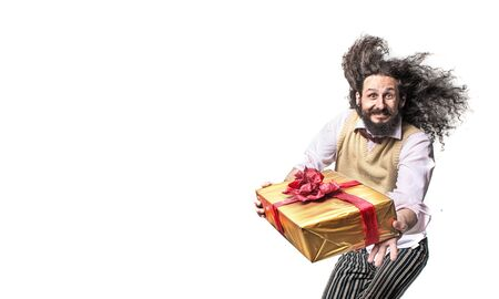 Nerdy guy holding a packed present - isolated