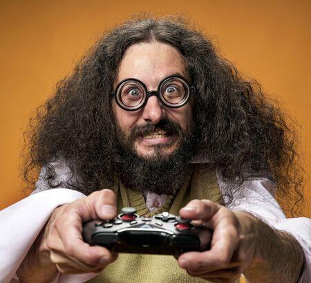 Closeup portrait of a focused, bizarre gamer