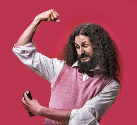Eccentric guy splashing deodorant on a shirt